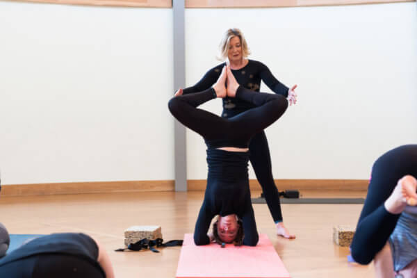 Yoga class tutoring students